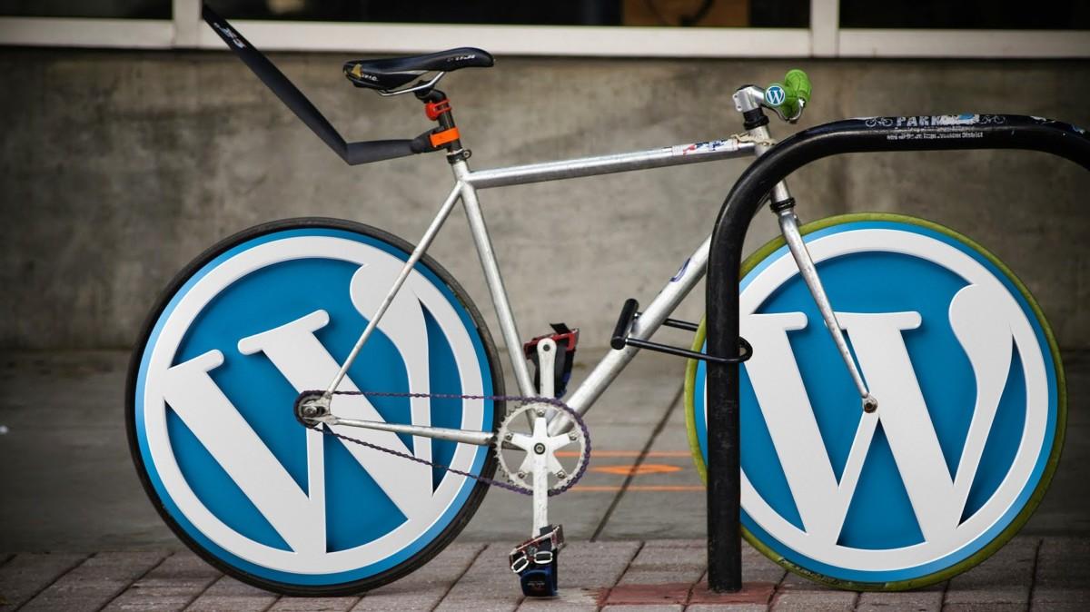 7 Gründe für Wordpress Bild Fahrrad mit Wordpress Logos